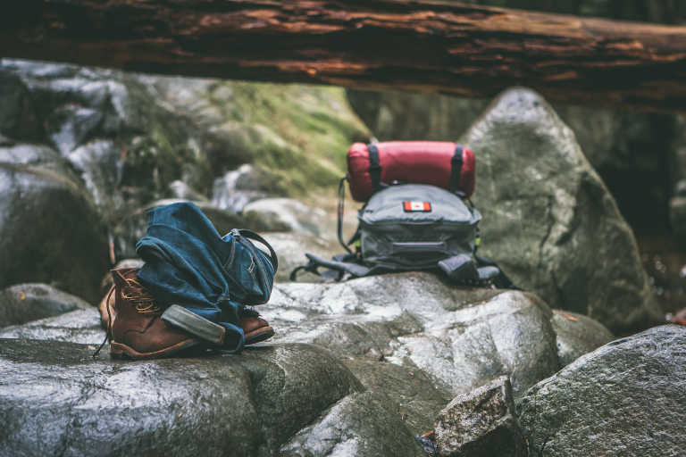 hiking gear on stones