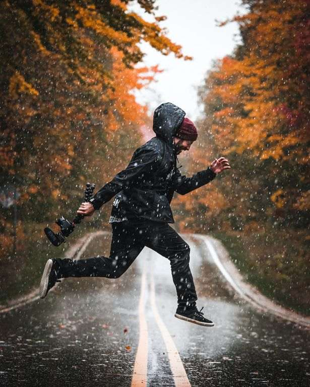 man wearing a windbreaker in the rain