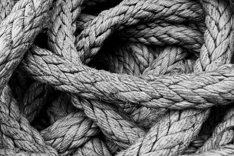 greyscale image of a braided rope