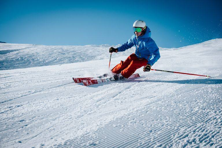 person skillfully skiing downhill