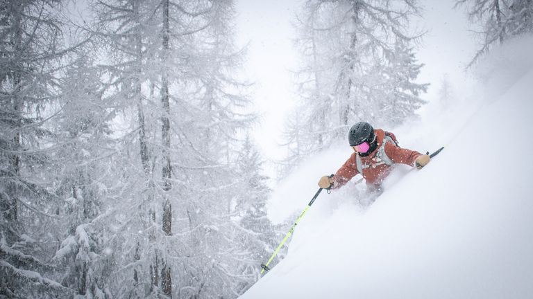 person skiing on a difficult slope level