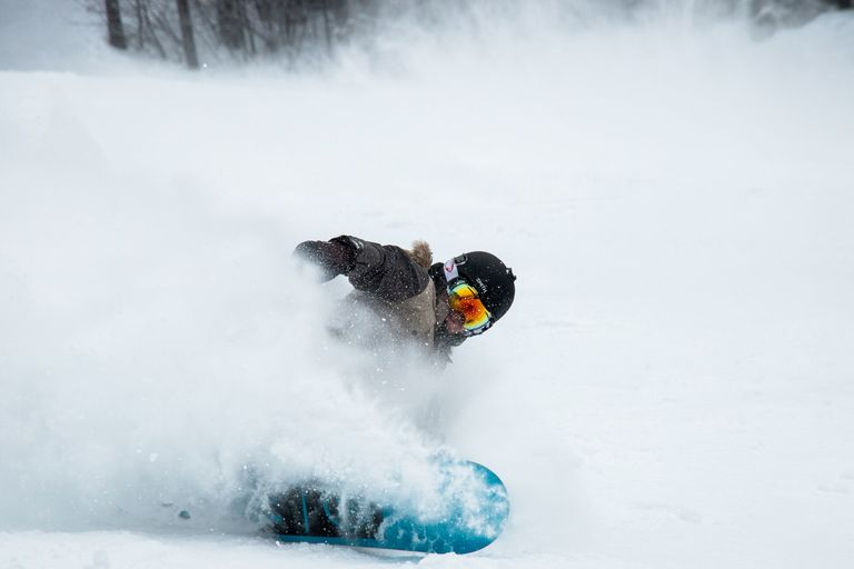 snowboarder breaking to a stop
